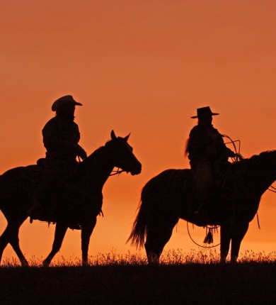 Silhouettes of cowboys on horseback at sunset, Source: Photodune.net